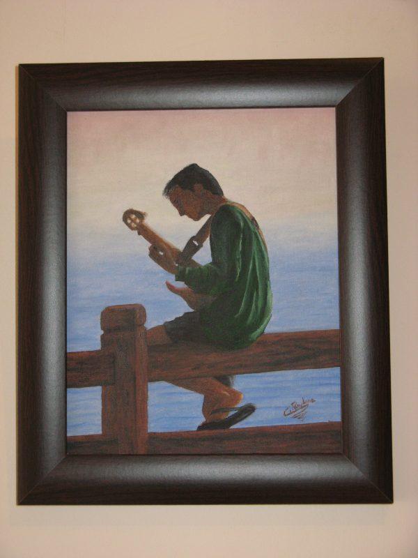 Cuadro realista pintado a mano con oleo sobre tablilla de un chico joven compositor musico tocando la guitarra